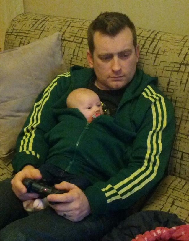 A gamer daddy knows how to multi-task and take care of his baby. He sure knows his dad duties!